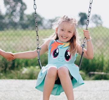 girl on swing at preschool